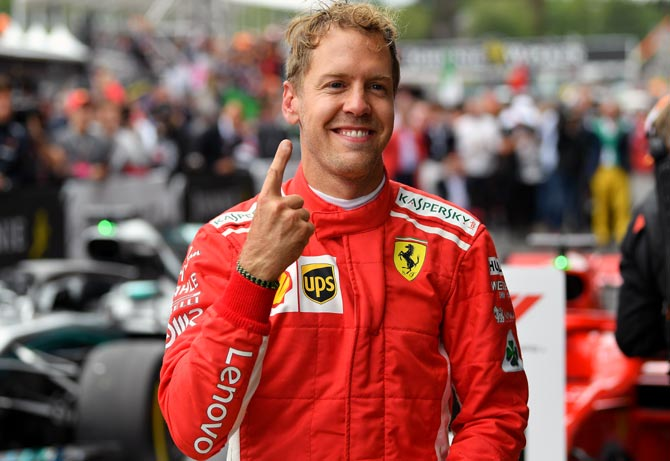 Rediff Sports - Cricket, Indian hockey, Tennis, Football, Chess, Golf - Ferrari's Vettel wins in Belgium to rein in Hamilton