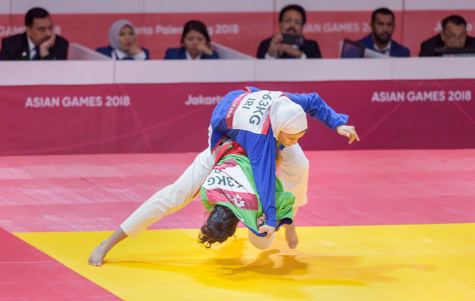 Indian Kurash player Binisha Biju Nayakattu (green) competes with Iran's Azar Koolivand in the women's 63kg (R32) Kurash at the 18th Asian Games Jakarta-Palembang 2018, in Jakarta, Indonesia on Wednesday