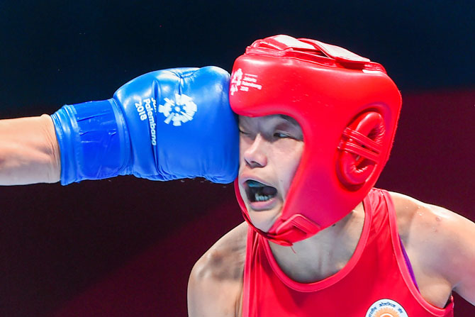 India's Samjetsabam Sarjubala and Chinas Chang Yuan during the women's fly (51 kg) quarter-final boxing event, in 18th Asian Games 2018, in Jakarta on Wednesday