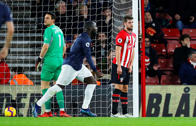 Manchester United's Romelu Lukaku celebrates their second goal as Southampton's Jack Stephens and Alex McCarthy look dejected during their match at St Mary's Stadium in Southampton