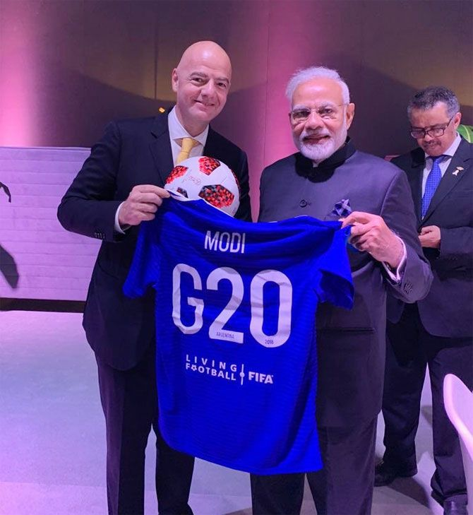 FIFA president Gianni Infantino gives PM Modi a personalised jersey at the G20 Summit in Buenos Aires on Saturday
