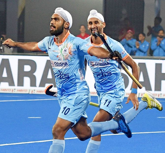 Indian hockey player Simranjeet Singh celebrates a goal during a match against Belgium during the Men's Hockey World Cup in Bhubaneswar on Sunday