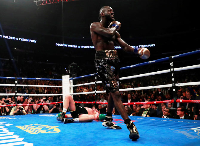 Deontay Wilder reacts after knocking down Tyson Fury during the WBC World Heavyweight Title bout at Staples Centre, Los Angeles on Saturday