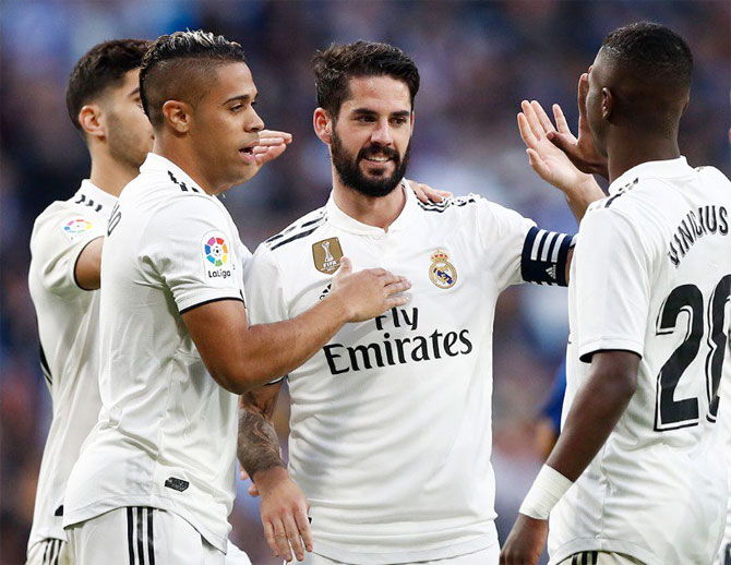 Real Madrid's Isco Alarcon celebrates with teammates after scoring against Melilla on Thursday. It was the first time he scored since September