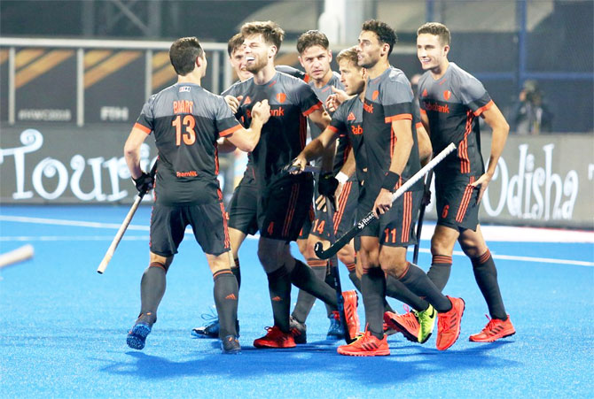 Netherlands' players celebrate a goal against Canada in their cross over match at the hockey World Cup in Bhubaneswar on Tuesday