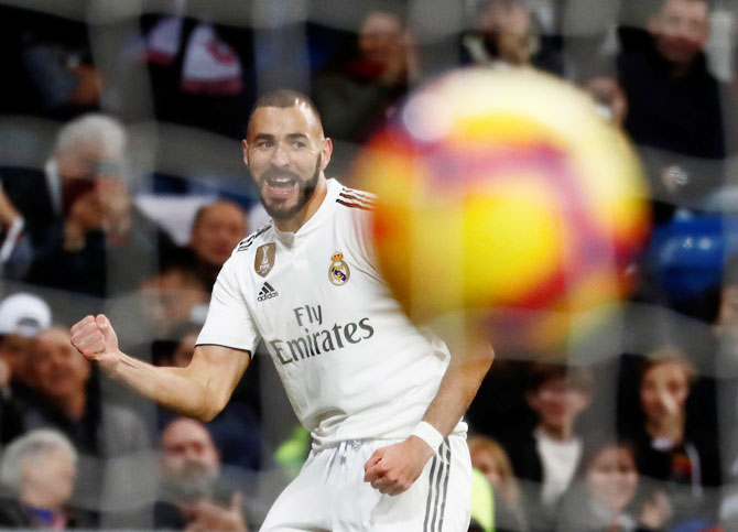 Real Madrid's Karim Benzema celebrates on scoring against Rayo Vallecano during the La Liga match at Santiago Bernabeu in Madrid on Saturday