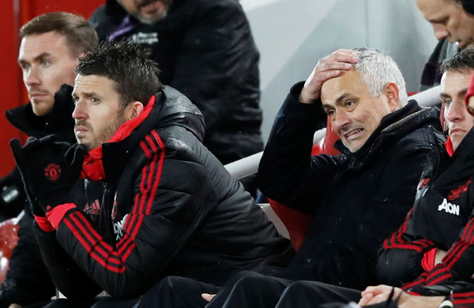 Manchester United manager Jose Mourinho reacts as assistant coach Michael Carrick looks on