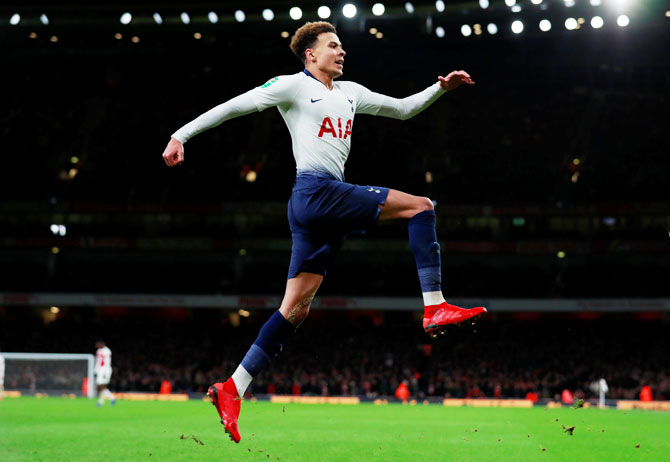 Tottenham's Dele Alli celebrates scoring their second goal against Arsenal during the League Cup quarter-finals at Emirates Stadium in London on Wednesday