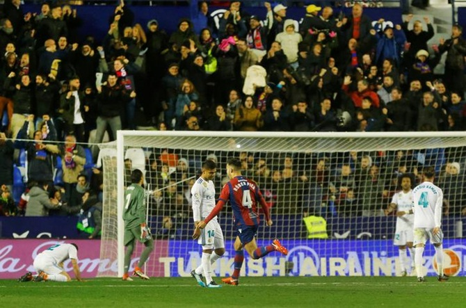 Real Madrid's Casemiro and Marcello are stunned after Levante's second goal.