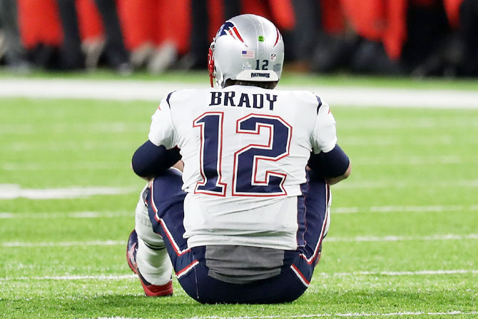 Tom Brady #12 of the New England Patriots reacts after fumbling the ball during the fourth quarter against the Philadelphia Eagles in Super Bowl LII final at US Bank Stadium on Sunday