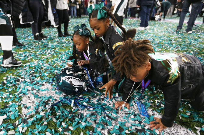 Philadelphia Eagles cornerback Patrick Robinson's (not pictured) kids play in confetti