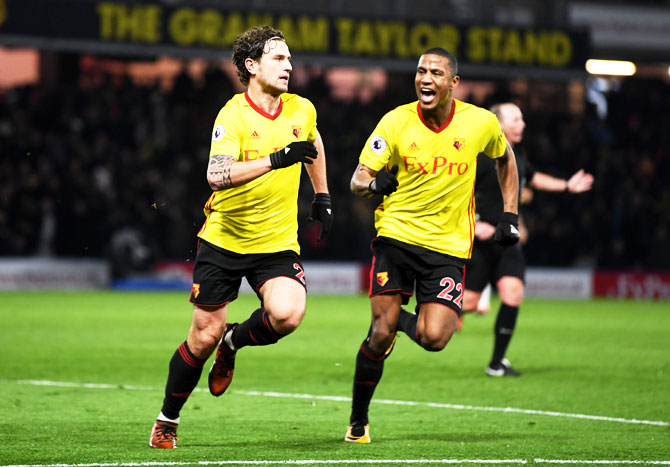 Watford's Daryl Janmaat celebrates with teammate Marvin Zeegelaar scoring the 2nd goal of Watford during the Premier League match between Watford and Chelsea at Vicarage Road in Watford on Tuesday