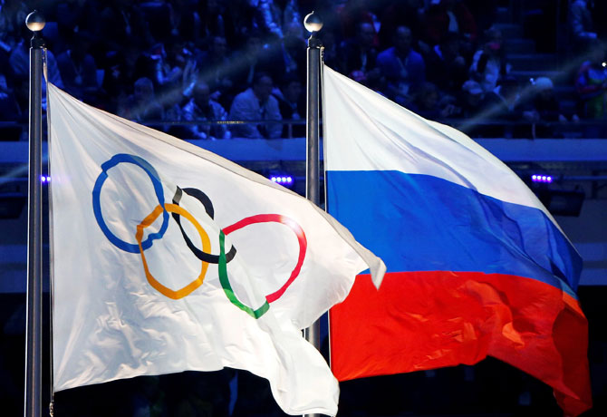The Russian national flag (R) and the Olympic flag