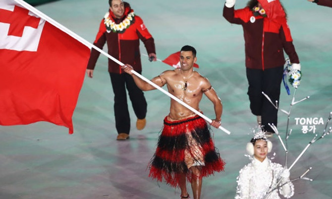 Flag bearer Pita Taufatofua of Tonga at the 2018 Winter Olympics in PyeongChang