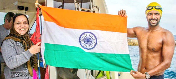 Pune-based Rohan More holds up the tri-colour on completing his feat