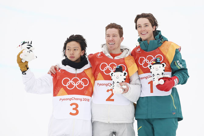 Silver medalist Ayumu Hirano of Japan, gold medalist Shaun White of the United States and bronze medalist Scotty James of Australia pose during the victory ceremony for the snowboard men's halfpipe final on Wednesday