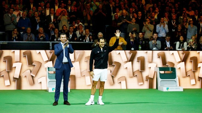 Roger Federer and Tournament Director Richard Krajicek, left, acknowledge the audience at the ATP 500 - Rotterdam Open