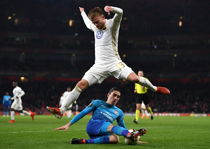 Ostersunds FK's Dennis Widgren evades a challenge by Arsenal's Hector Bellerin during their UEFA Europa League Round of 32 match at the Emirates Stadium in London on Thursday