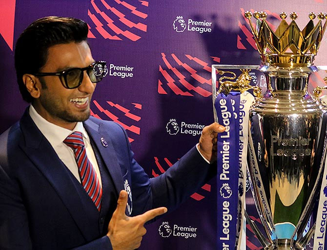 Brand Ambassador for EPL in Indiia, Ranveer Singh poses with Premier League Trophy at the event on Friday