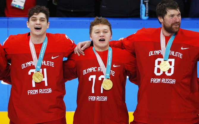 Members of Russia's Ice Hockey Olympic team Nikolai Prokhorkin (left) and teammates Kirill Kaprizov and goalie Vasili Koshechkin sing the national anthem after winning the gold medal at the Gangneung Hockey Centre in Gangneung, South Korea  on Sunday