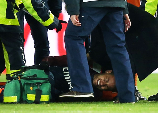 Paris Saint-Germain's Neymar receives treatment from medical staff after sustaining an injury during their Ligue 1 match against Olympic Marsielle at Parc des Princes Stadium in Paris on Sunday