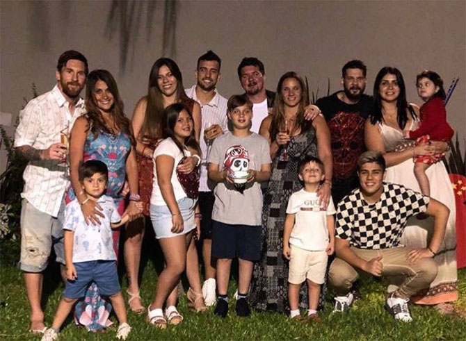 FC Barcelona's superstar Lionel Messi (left) joined his family his family in wishing his followers 'Feliz 2018!!'