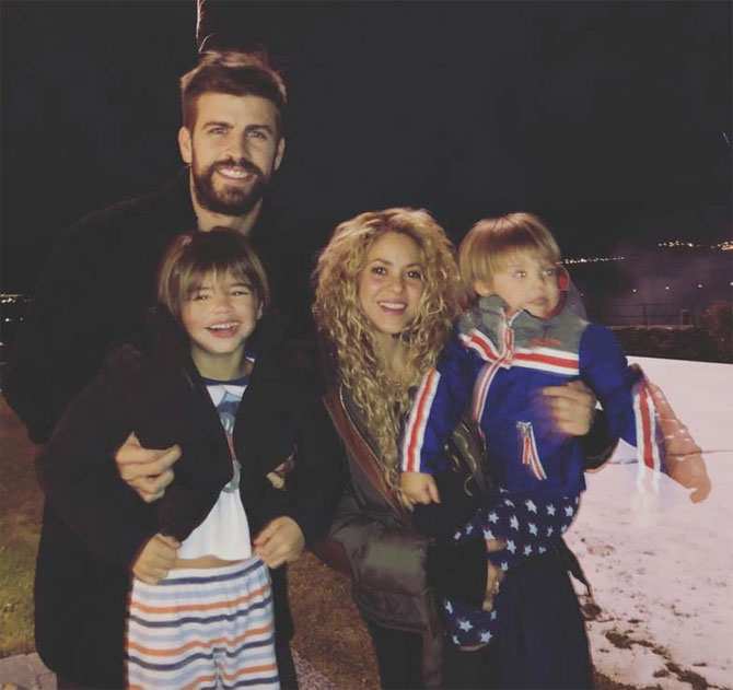 Barcelona defender Gerard Pique and girlfriend singer Shakira and their two kids took to Instagram to wish fans 'A Happy 2018'