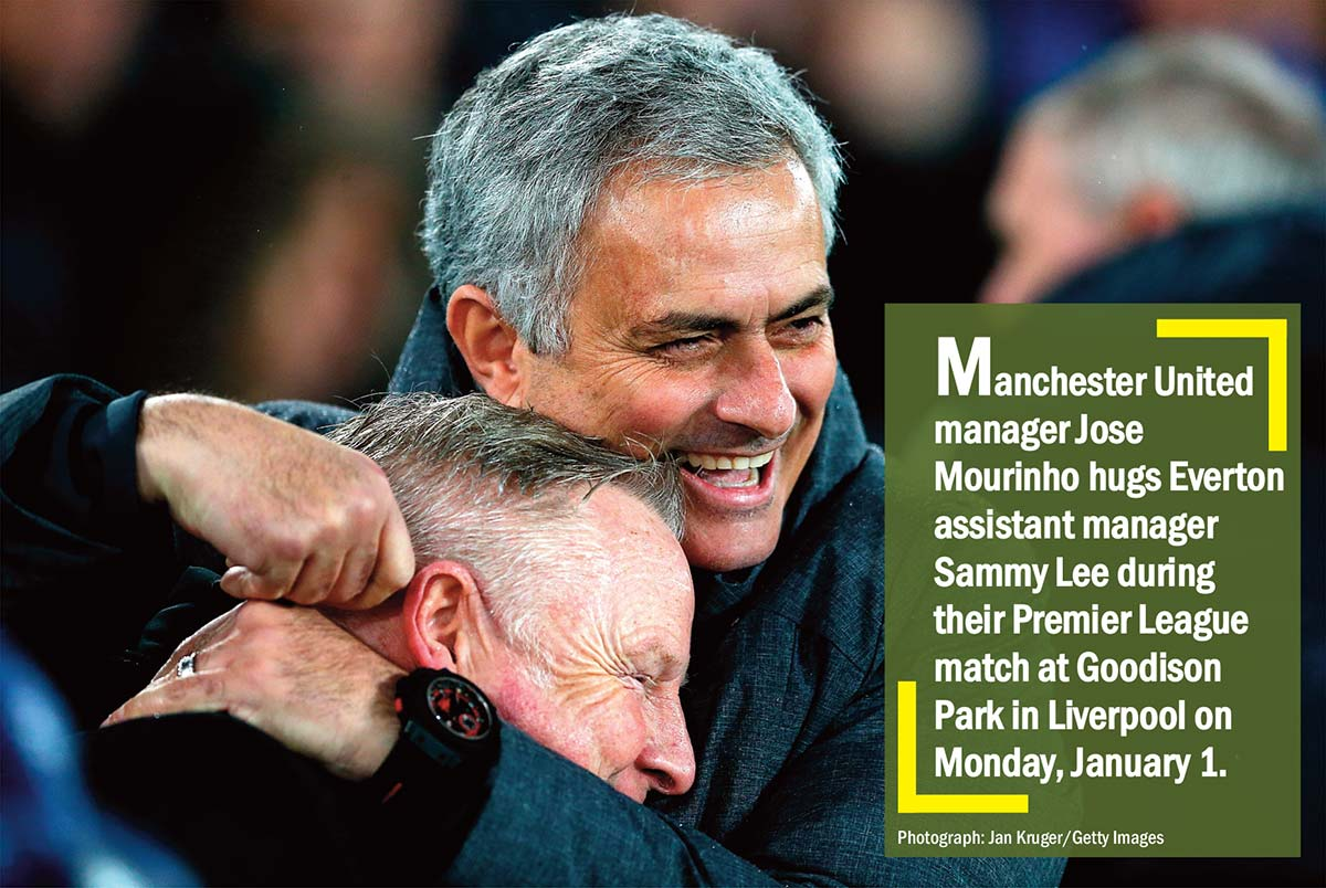Manchester United manager Jose Mourinho hugs Everton assistant manager Sammy Lee during their Premier League match at Goodison Park in Liverpool on Monday, January 1