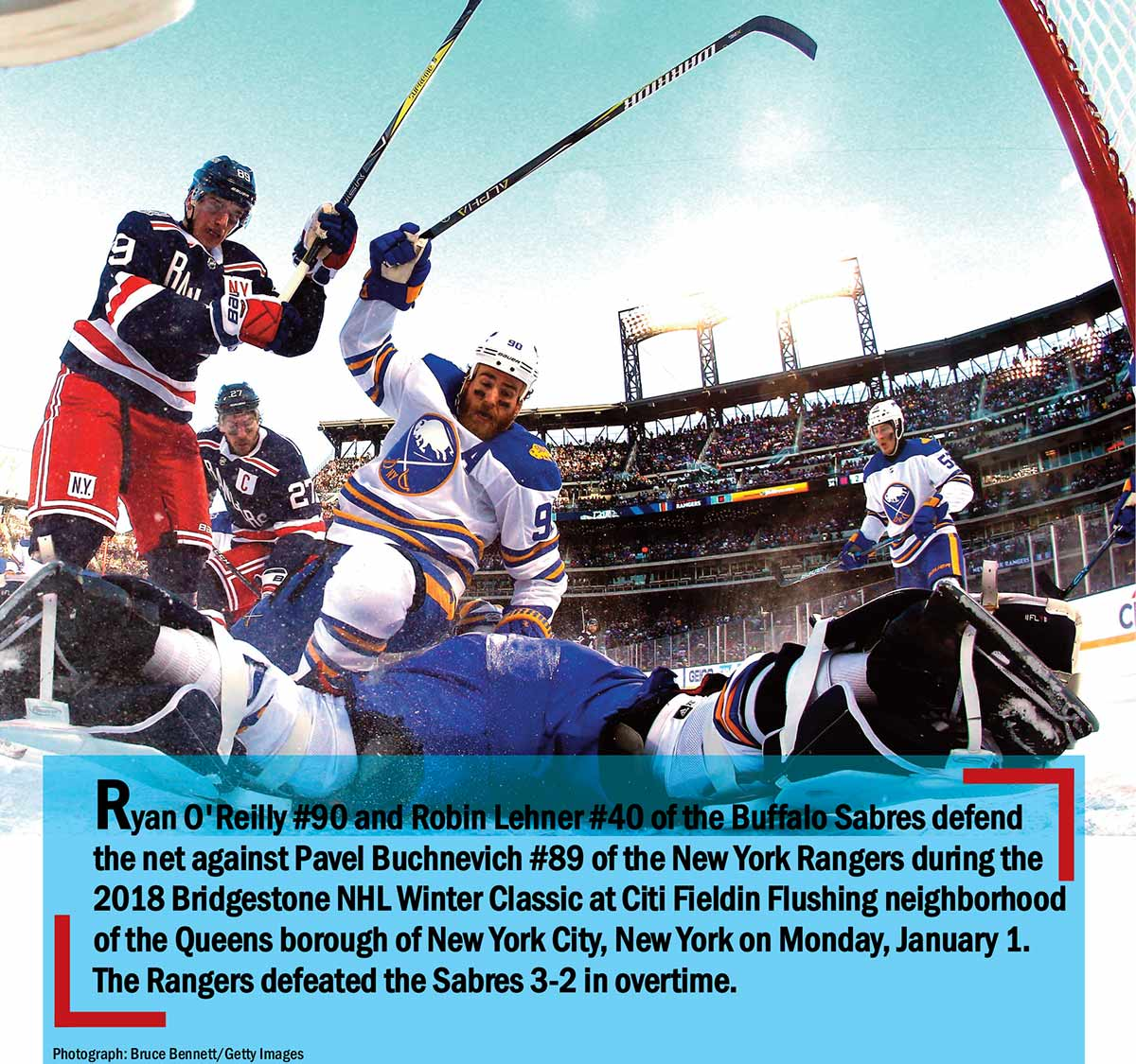 Ryan O'Reilly #90 and Robin Lehner #40 of the Buffalo Sabres defend the net against Pavel Buchnevich #89 of the New York Rangers during the 2018 Bridgestone NHL Winter Classic at Citi Fieldin Flushing neighborhood of the Queens borough of New York City, New York on Monday January 1. The Rangers defeated the Sabres 3-2 in overtime.
