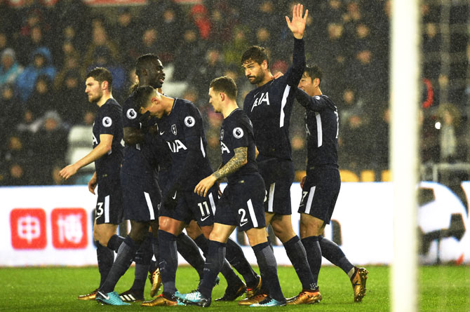 Tottenham Hotspur's Fernando Llorente celebrates with teammates after netting his side's first goal against Swansea City at Liberty Stadium in Swansea, Wales
