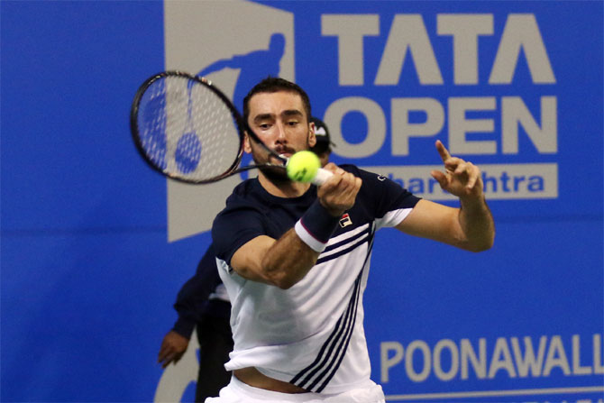 Croatian top seed, Marin Cilic plays a return against India's Ramkumar Ramanathan during his 2nd round victory at the Tata Open Maharashtra in Pune on Wednesday