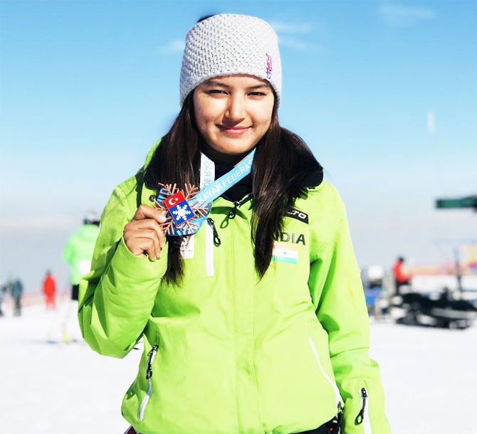 Indian skier Aanchel Thakur shows off her medal