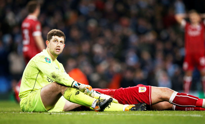 Bristol City's Frank Fielding looks dejected after Manchester City scored the winner