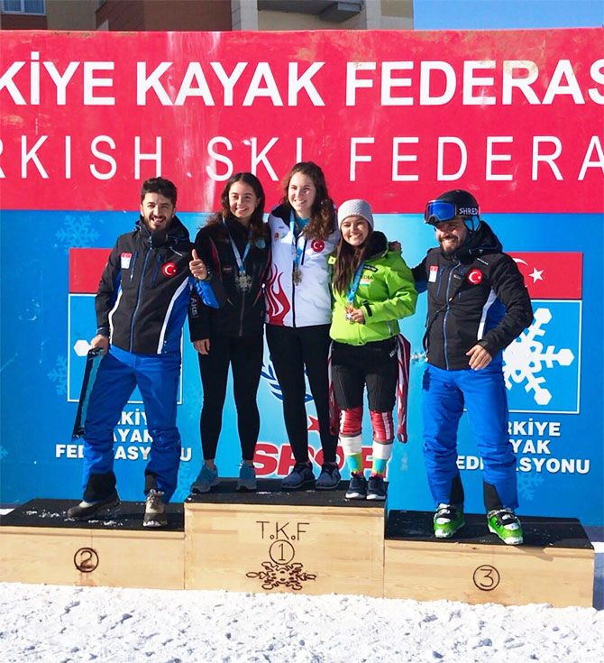 India's Aanchal Thakur (right) poses with her medal on the podium