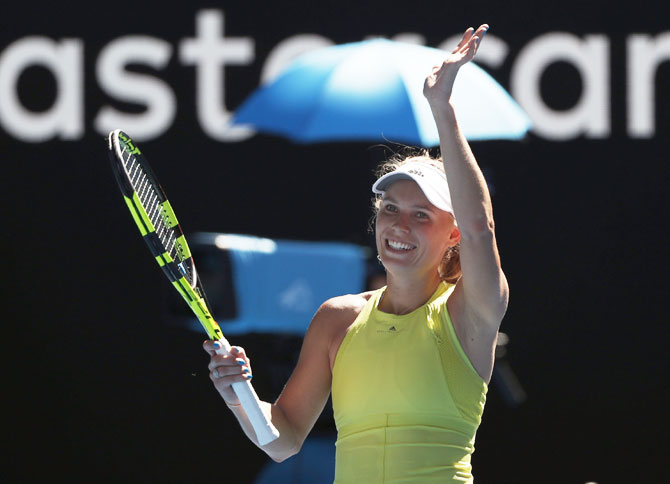 Denmark's Caroline Wozniacki celebrates on beating Croatia's Jana Fett