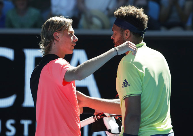 Jo-Wilfried Tsonga is congratulated by chats Denis Shapovalov after his victory