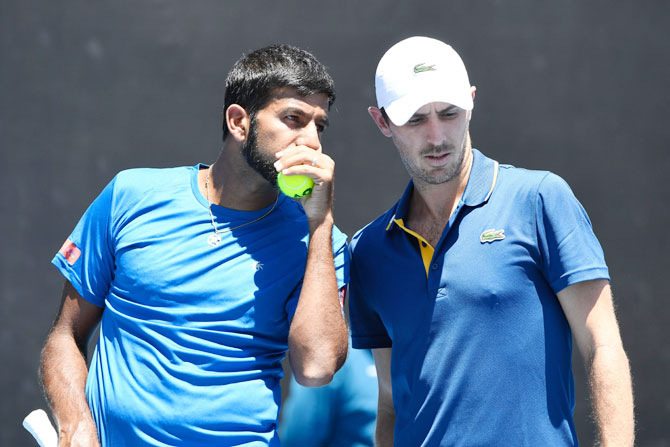 India's Rohan Bopanna (left) and France's Edouard Roger-Vasselin talk tactics in their first round men's doubles match against USA's Ryan Harrison and Canada's Vasek Pospisil on day four of the 2018 Australian Open at Melbourne Park on Thursday