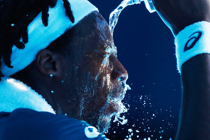 Gael Monfils cools down between games in his second round match against Novak Djokovic