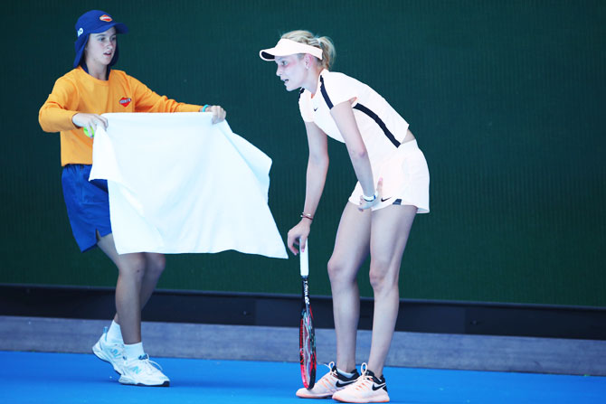 Croatia's Donna Vekic receives a towel from a ball kid during her second round match against Angelique Kerber
