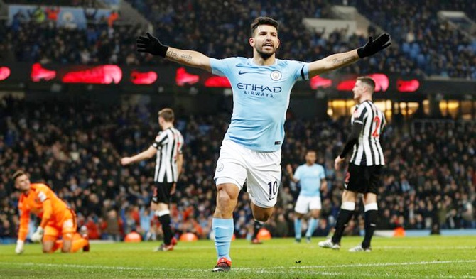 PHOTOS: Aguero treble gets City back on track; United keep up chase