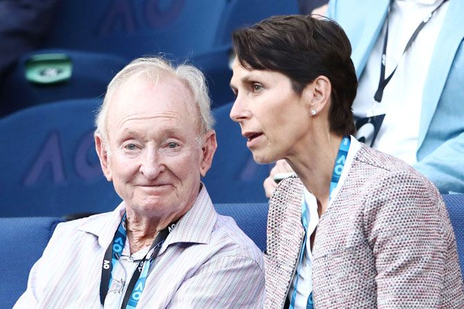 Australian tennis legend Rod Laver (right) enjoying the proceedings during the thrilling encounter
