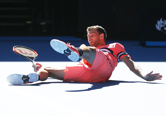 Grigor Dimitrov falls during his match against Kyle Edmund