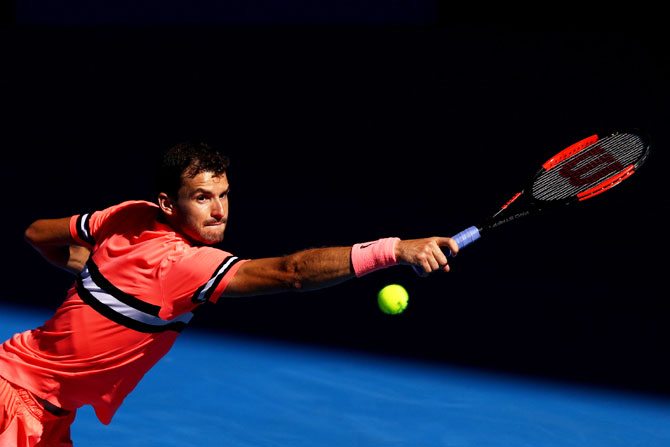 Bulgaria's Grigor Dimitrov plays a backhand return in his quarter-final match against Great Britain's Kyle Edmund