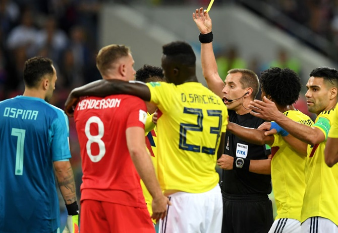 Wilmar Barrios of Colombia is shown a yellow card by referee Mark Geiger