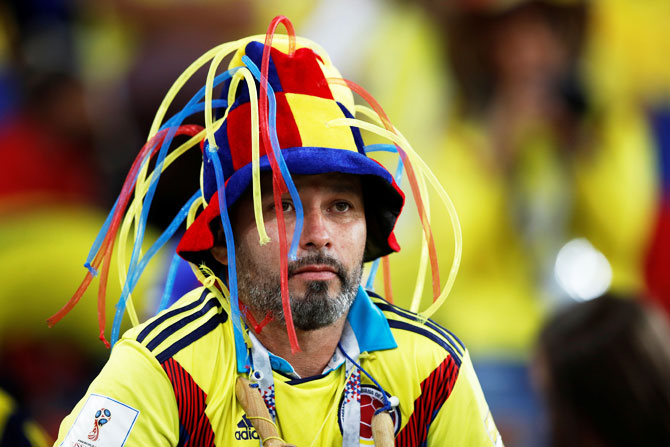 A Colombia fan looks dejected after losing the penalty shootout