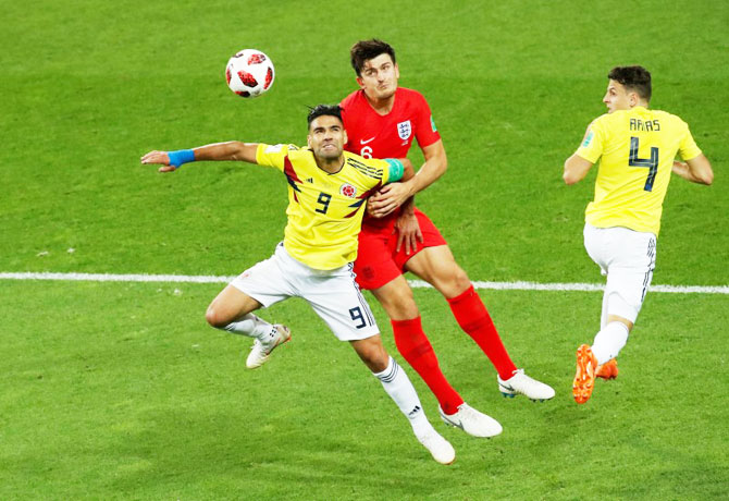 England's Harry Maguire in action with Colombia's Radamel Falcao