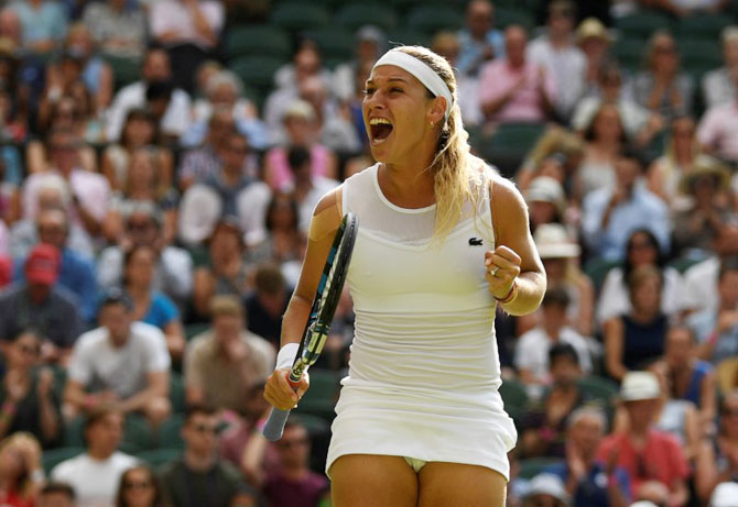 Slovakia's Dominika Cibulkova celebrates winning the second round match against Britain's Johanna Konta