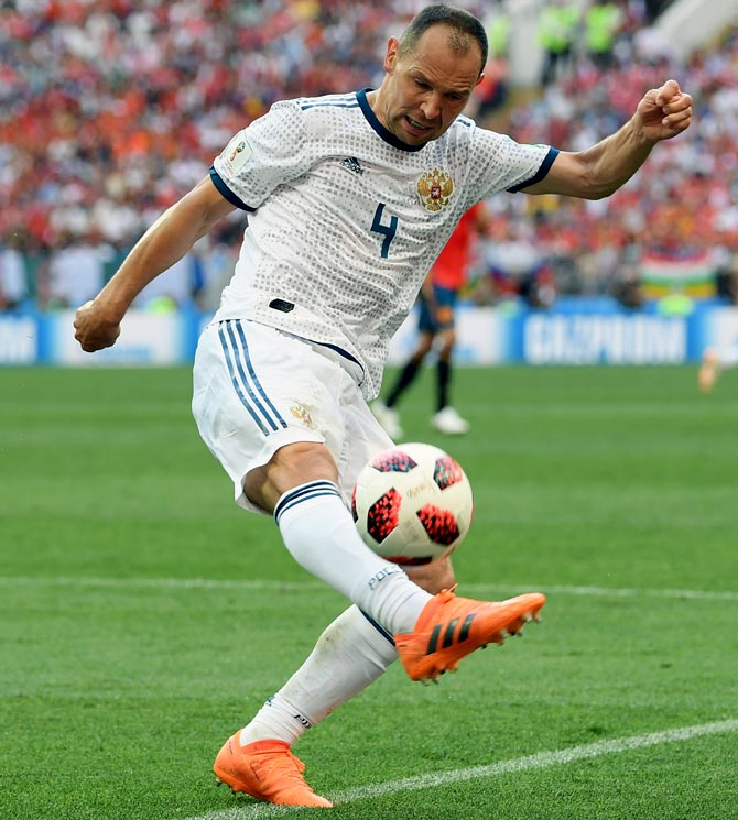 Russia record holder Ignashevich retires after World Cup exit