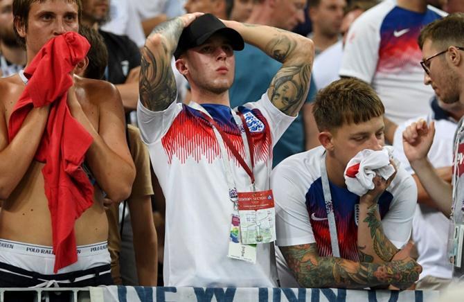 PIX: Hopes dashed, England fans taste bitter defeat once again