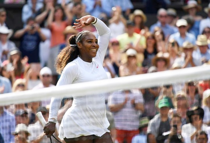 Serena Williams of the United States celebrates beating Germany's Julia Goerges in the semi-finals of the Wimbledon Championships on Thursday